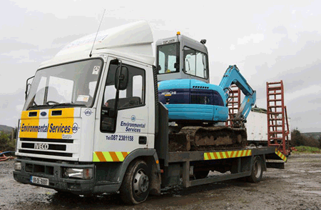 Lorry with digger and trailer